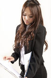 Asian office lady in black suit Folder in hand Royalty Free Stock Images
