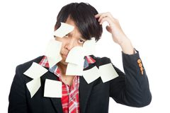 Asian office man covered in blank notes. Isolated on white background royalty free stock photos