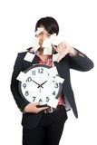 Asian office man hold clock covered in blank notes with thumbs. Down isolated on white background royalty free stock photos