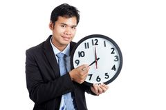 Asian office man smile hold a clock arm Stock Images