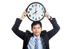 Asian office man smile show a clock over his head Stock Photos
