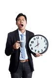 Asian office man yawn with a clock and a cup of coffee Royalty Free Stock Photos