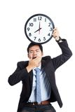 Asian office man yawn show a clock over his head Stock Image
