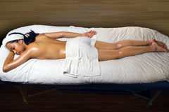 Asian Oil Massage at Spa. Detail of a young Asian woman resting after enjoying an oil massage royalty free stock image
