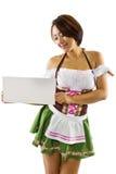 Asian Oktoberfest Waitress. Young Asian bartender wearing a German Oktoberfest  costume Royalty Free Stock Image