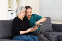 Asian old couple using tablet together Stock Photos