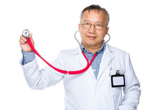 Asian old doctor hold with stethoscope Royalty Free Stock Images