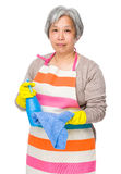 Asian old housewife with rag and bottle spray Royalty Free Stock Photography