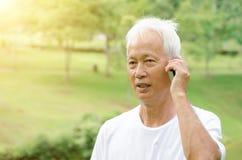 Asian old man calling phone Stock Photography