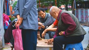 Asian old man playing chess stock photos
