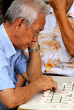 Asian old man playing GO Royalty Free Stock Photos