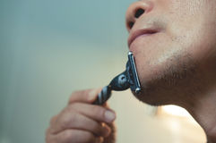 Asian old man is shaving his beard. Close up, Asian old man is shaving his beard, Vintage and retro Stock Photography
