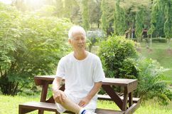Asian old man sitting at the park Stock Image