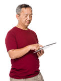 Asian old man use of digital tablet Stock Images