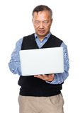 Asian old man use of laptop computer Royalty Free Stock Photography