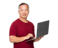 Asian old man use of laptop computer Stock Photos