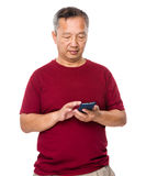 Asian old man use of mobile phone Stock Image