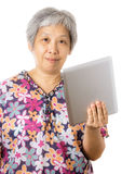 Asian old woman with digital tablet Stock Images