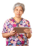 Asian old woman with digital tablet Stock Photos