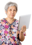 Asian old woman with digital tablet Stock Photography