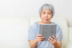 Asian old woman with digital tablet Stock Image