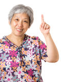 Asian old woman pointing up Royalty Free Stock Photo