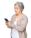 Asian Old woman read message of cellphone Royalty Free Stock Photos