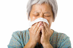 Asian old woman sneezing Royalty Free Stock Image