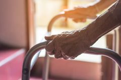 Asian old woman standing with her hands on a walker stand,Hand o royalty free stock images