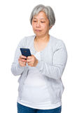Asian old woman use of cellphone Royalty Free Stock Image