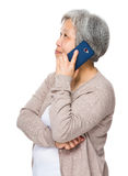 Asian Old woman use of cellphone Stock Image