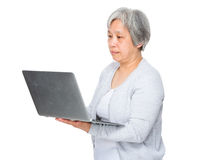 Asian old woman use of the laptop computer Royalty Free Stock Image