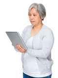 Asian old woman use of tablet Stock Image