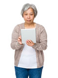 Asian Old woman use of tablet Royalty Free Stock Images