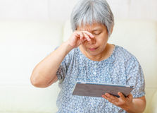Asian old woman using digital tablet Royalty Free Stock Images