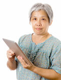 Asian old woman using tablet Stock Images