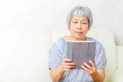 Asian old woman using tablet Royalty Free Stock Image