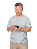 Asian Older man use of the mobile phone Royalty Free Stock Images
