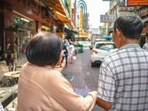 Asian Older sister and younger brother Walking in china town str stock images