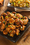 Asian Orange Chicken with Green Onions stock images