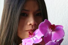 Asian with orchids royalty free stock photos
