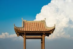 Asian oriental Buddhism temple roof against blue cloudy sky Royalty Free Stock Photos