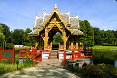 The Asian pagoda. Against lake and wood Royalty Free Stock Images