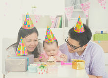 Asian parent with baby stock images