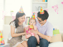 Asian parent with baby stock image