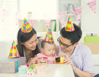 Asian parent with baby stock photography