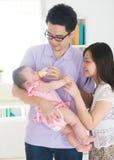 Asian parent nursing their baby Stock Photography