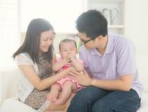 Asian parent playing with baby stock photos