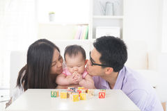 Asian parent playing with baby Royalty Free Stock Photography