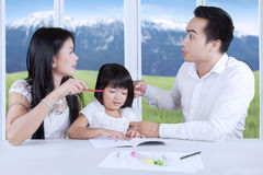 Asian parents arguing in front of their child Stock Photos